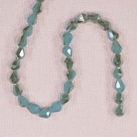 7 mm by 5 mm faceted aqua glass teardrop beads